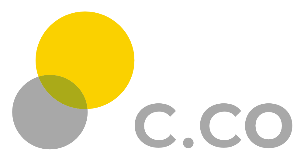 We Are C brand logo in yellow and grey